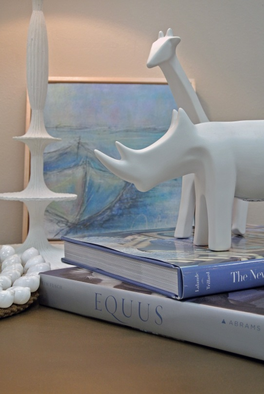 A ceramic giraffe or rhino for the animal lover in the family? Only $31.25 each!
